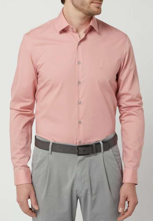 Calvin Klein Slim Fit Business-Hemd aus Popeline (vers. Farben) zu je 25,49€inkl. Versand (statt 40€)