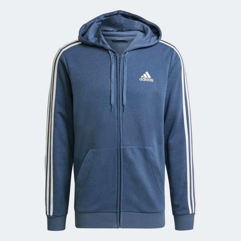Adidas Essentials French Terry 3-Streifen Kapuzenjacke in Blau für 28,80€ inkl. Versand (statt 43€)