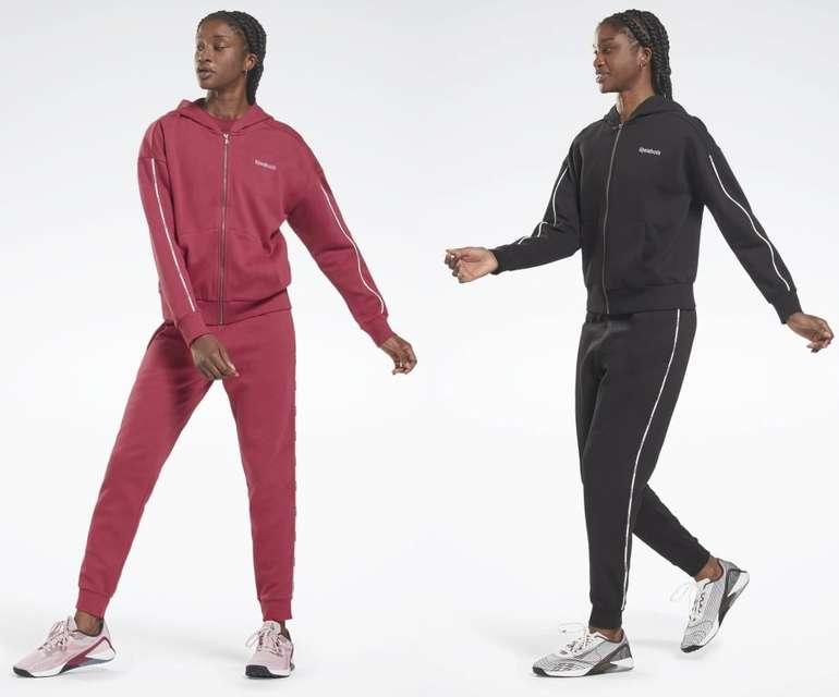 Reebok Piping Hooded Set Damen Trainingsanzug für 52,50€ inkl. Versand (statt 75€)
