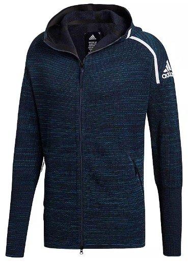 Sportscheck: 20€ Rabatt auf ausgewählte Artikel z.B. Adidas Kapuzenjacke 83,90€