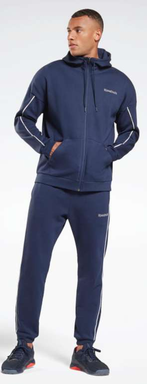 Reebok Training Essentials Piping Trainingsanzug für 41,65€ inkl. Versand (statt 85€)