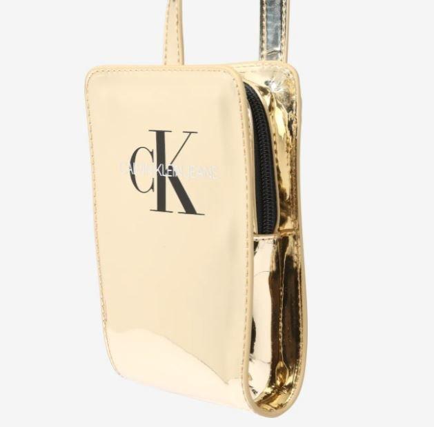 Calvin Klein Jeans Crossbody Tasche in Gold für 29,90€ inkl. Versand (statt 34€)